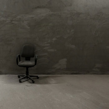 Chair in front of a grey wall